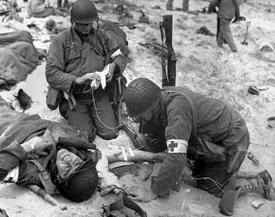 Photograph - Medics Treat A Wounded U.s. Soldier by Everett