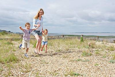Mother And Children On Beach Art Print by Ian Hooton