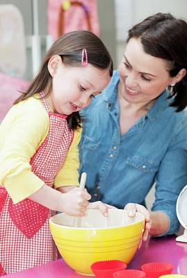 Mixing Bowls Photograph - Mother And Daughter Baking by Ian Hooton