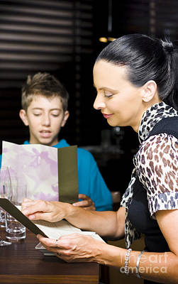 Ordering Photograph - Mother And Son Consulting Menus by Jorgo Photography - Wall Art Gallery
