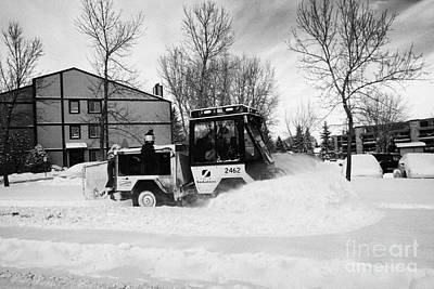 municipal city mini tractor clearing sidewalks and roads in Saskatoon Saskatchewan Canada Art Print by Joe Fox