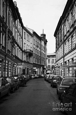 Cracovia Photograph - Narrow Street With On Street Both Sides Parking In Krakow by Joe Fox