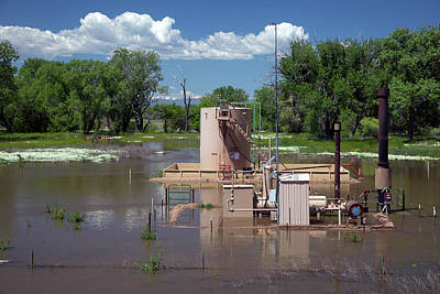 River Flooding Photograph - Oil Well Flooded By River by Jim West
