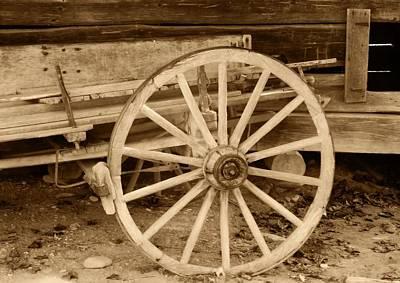 Wooden Farm Wagon Photograph - Old Wagon Wheel by Dan Sproul