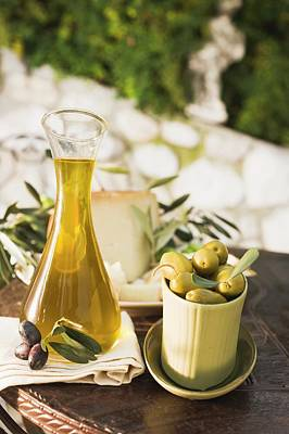 Olives, Olive Oil, Cheese And Crackers On Table Out Of Doors Art Print