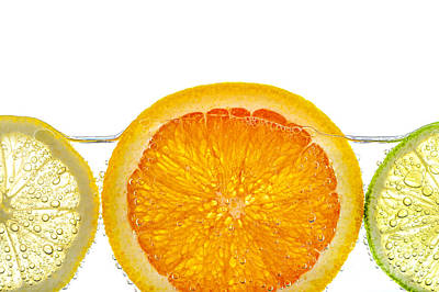 Limes Photograph - Orange Lemon And Lime Slices In Water by Elena Elisseeva