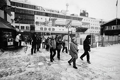 Passengers In A Snow Blizzard Leaving The Hurtigruten Passenger Terminal Hammerfest Finnmark Norway  Art Print by Joe Fox