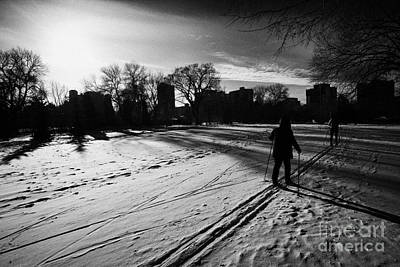 people cross country skiing in kinsmen park Saskatoon Saskatchewan Canada Print by Joe Fox