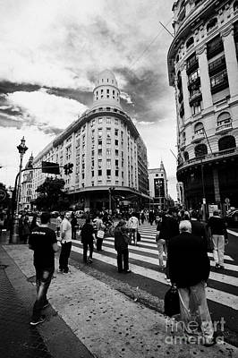 Crosswalk Photograph - people crossing calle florida Edificio Bencich and south end of florida street downtown Buenos Aires by Joe Fox