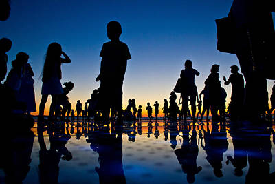 Photograph - People Reflections On Colorful Sunset by Brch Photography
