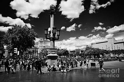 Crosswalk Photograph - People Walking Across Busy Pedestrian Crossing Placa De Catalunya Barcelona Catalonia Spain by Joe Fox