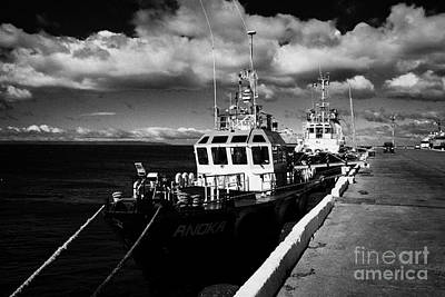 Muelle Photograph - pilot ships moored in Punta Arenas port Chile by Joe Fox