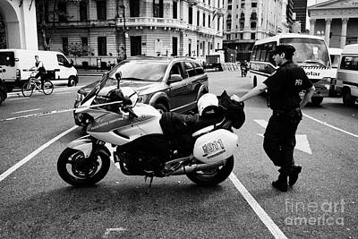 Policia Federal Argentina Federal Police Motorcycle Traffic Cop On Duty At Road Restriction Downtown Art Print by Joe Fox