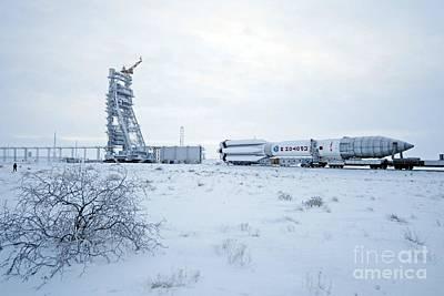 Comsats Photograph - Proton M Rocket Near Its Launch Pad by RIA Novosti