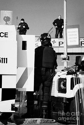 Psni Officers In Protective Riot Gear At Landrovers And Snipers On Crumlin Road At Ardoyne Shops Bel Art Print