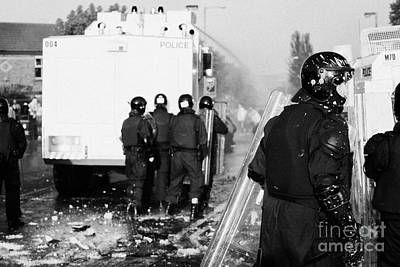 Terrorist Photograph - Psni Riot Officers Behind Water Canon During Rioting On Crumlin Road At Ardoyne Shops Belfast 12th J by Joe Fox