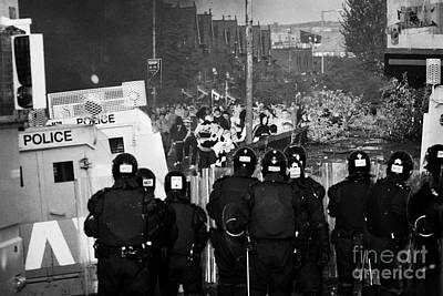 Terrorist Photograph - Psni Riot Officers Face Rioters Mob On Crumlin Road At Ardoyne Shops Belfast 12th July by Joe Fox