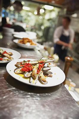 Razor Clams Wall Art - Photograph - Razor Clams On A Plate In A Restaurant by Eric Kulin