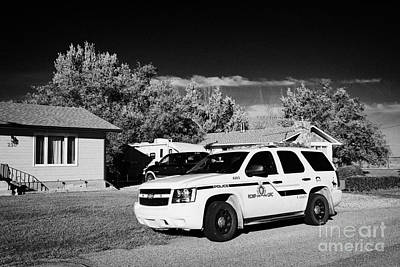 rcmp police patrol car parked outside a small town house in rural Saskatchewan Canada Art Print