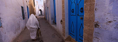 Africa Tiles Photograph - Rear View Of A Woman Walking by Panoramic Images