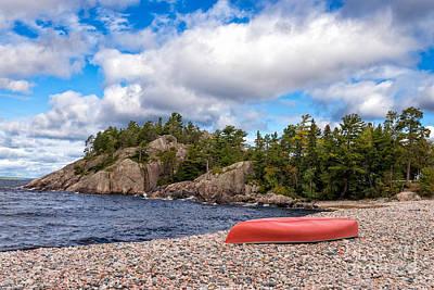 Canoe Photograph - Red Canoe On A Pebble Beach by Les Palenik
