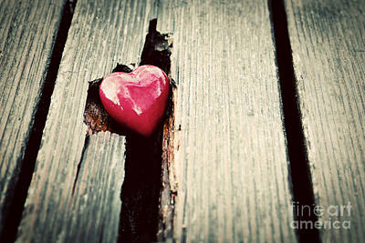 Close-up Photograph - Red Heart In Crack Of Wooden Plank by Michal Bednarek