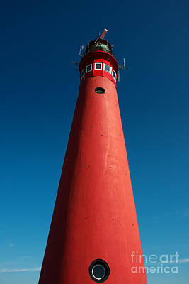 Red Lighthouse And Deep Blue Sky. Art Print by Jan Brons