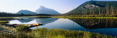 Canoe Photograph - Reflection Of Mountains In Water by Panoramic Images
