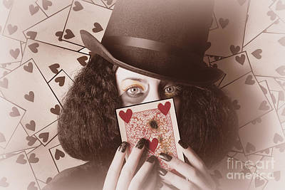 Fantasy Photos - Retro magician holding burnt playing card by Jorgo Photography - Wall Art Gallery