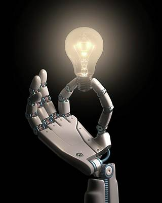 Robotic Hand Holding A Light Bulb Art Print by Ktsdesign