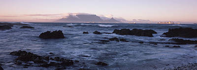 Table Mountain Photograph - Rocks In The Sea With Table Mountain by Panoramic Images