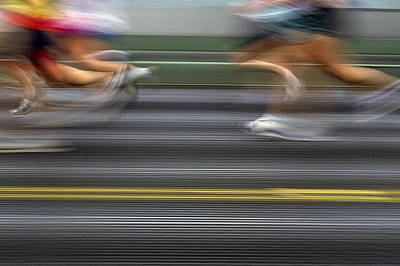 Runners Blurred Art Print by Jim Corwin