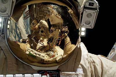 Manned Space Flight Photograph - Russian Cosmonaut During A Spacewalk by Nasa