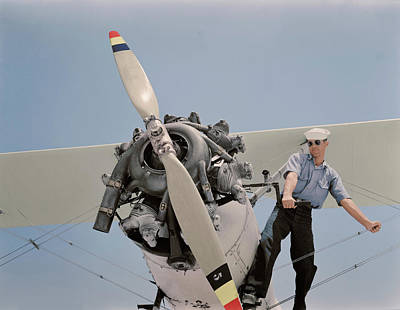 Naval Aircraft Photograph - Sailor Starts The Engine Of A N3n by Stocktrek Images