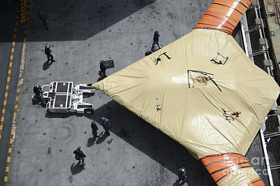 Uca Photograph - Sailors Move An X-47b Unmanned Combat by Stocktrek Images