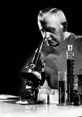 Scientist With Microscope Art Print by Underwood Archives