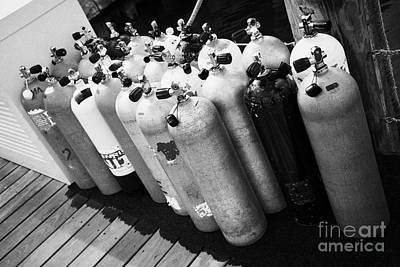 Scuba Air Tanks Lined Up On Jetty To Be Filled In Harbour Key West Florida Usa Print by Joe Fox