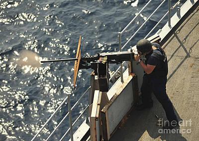 Seaman Fires A .50-caliber Machine Gun Art Print by Stocktrek Images