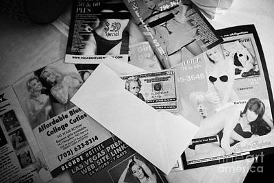 Selection Of Leaflets Advertising Girls Laid Out On A Hotel Bed With Us Dollars Cash In An Envelope  Art Print by Joe Fox