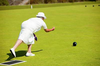 Pensioners Photograph - Seniors Playing Bowls At Penzance by Ashley Cooper