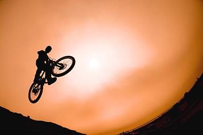 Silhouette Of Stunt Cyclist Print by Corey Hochachka
