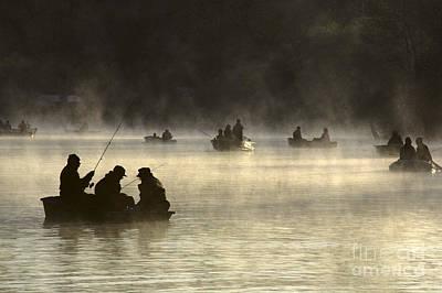 Photograph - Silhouetted Fishermen by Jim Corwin