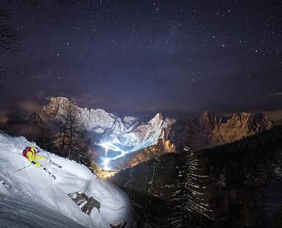 Skier Riding Down A Powder Slope At Night Art Print by Leander Nardin