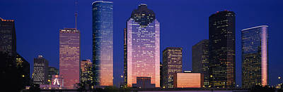 Crowd Scene Photograph - Skyscrapers Lit Up At Night, Houston by Panoramic Images
