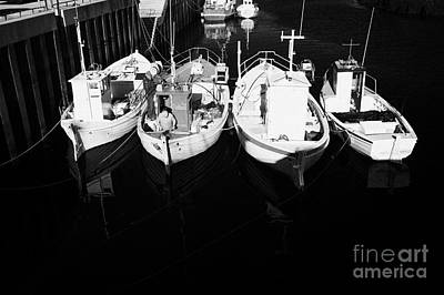 small fishing boats in bunbeg harbour county Donegal Republic of Ireland Art Print by Joe Fox