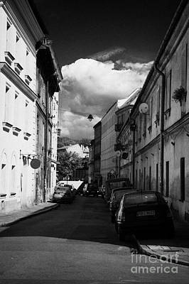 Cracovia Photograph - Small Narrow Street With On Street Parking In The Kazimierz District Of Krakow by Joe Fox