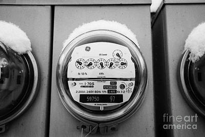 snow covered electricity meters in Saskatoon Saskatchewan Canada Art Print by Joe Fox