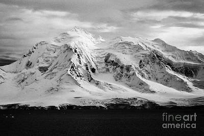 snow covered landscape of anvers island mountain range and neumayer channel Antarctica Art Print by Joe Fox