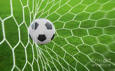 Soccer Ball In Goal  Art Print by Anek Suwannaphoom