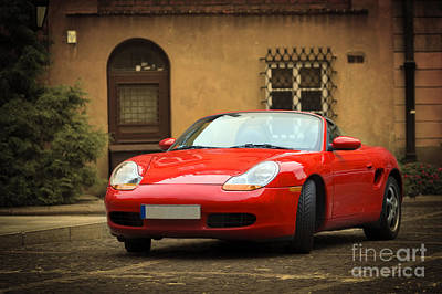 Wild And Wacky Portraits Rights Managed Images - Sport car in the old town scenery Royalty-Free Image by Michal Bednarek